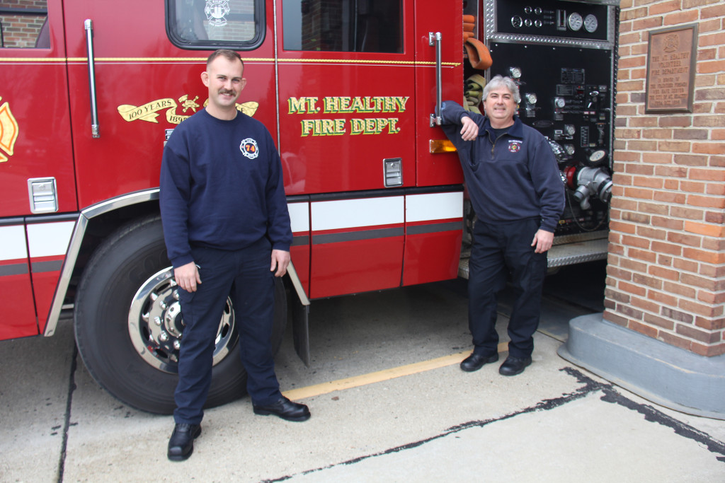 Right to left, Firefighters Logan Tuscany and Todd Marshall